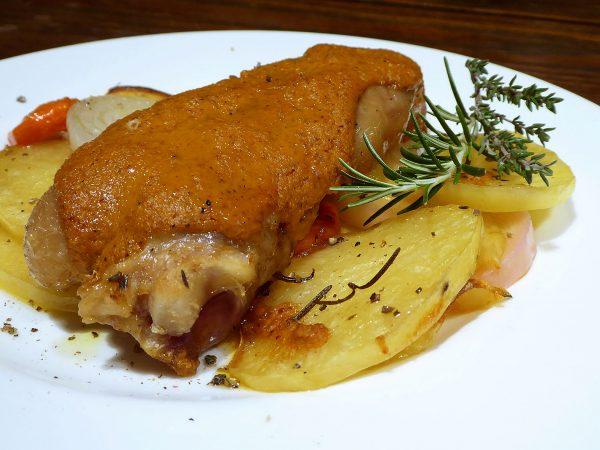 Peus de porc amb romesco